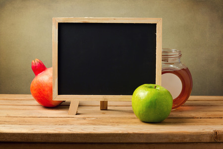 jewish food: Chalkboard with honey and apple for Jewish New Year Holiday