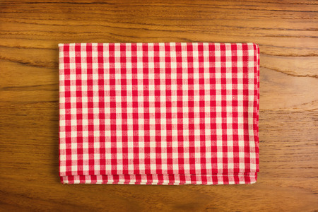 tablecloth: Checked tablecloth on wooden table Stock Photo