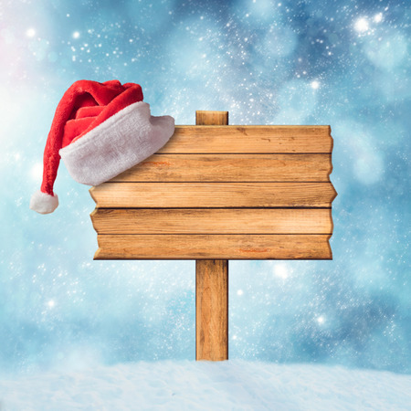 christmas cover: Wooden sign and Santa Claus Hat
