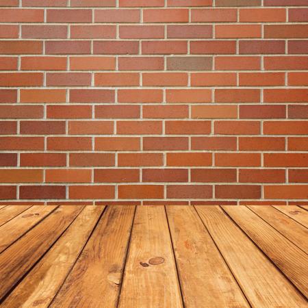 brick floor: Wooden deck floor over brick wall background