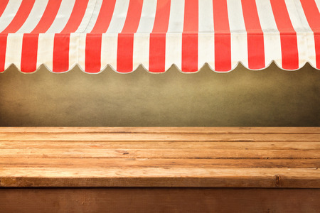 shop front: Empty wooden counter with awing