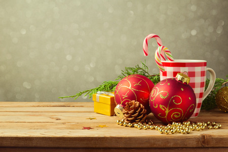 Christmas holiday background with checked cup and decorations