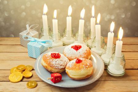 holiday food: Jewish holiday Hanukkah celebration with candles and food