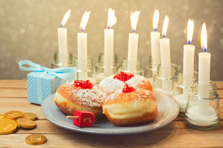 jewish food: Jewish holiday Hanukkah celebration with candles and food