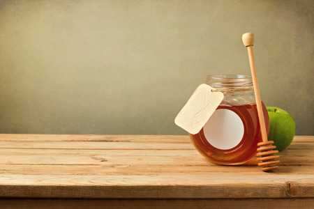 Honey and apple on wooden table with copy space Stock Photo
