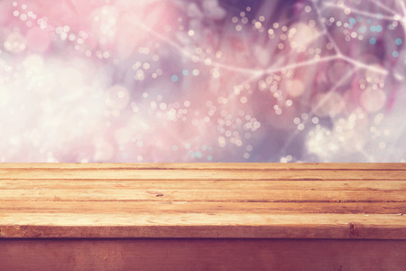Beautiful winter bokeh background and wooden table