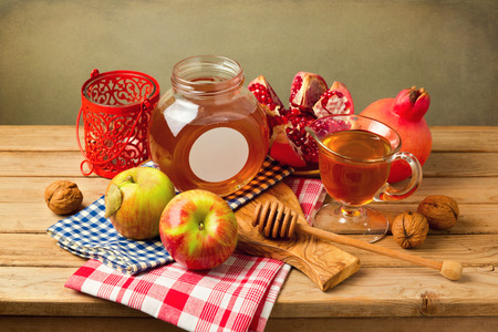 Pomegranate apple and honey on wooden table Stock Photo