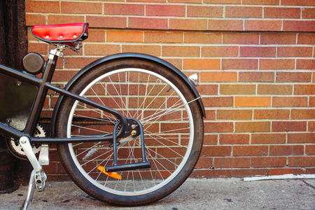 bike cover: Vintage bicycle detail over brick wall background