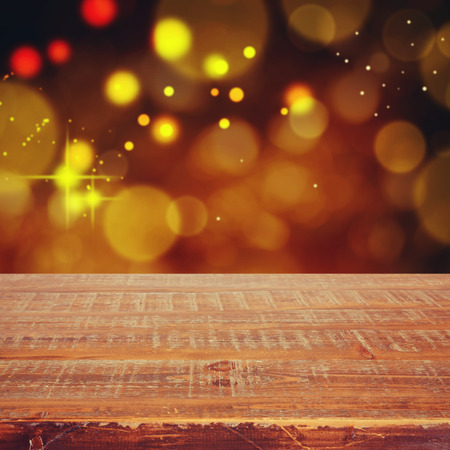 holiday lights display: Christmas holiday background with empty wooden table for display montage