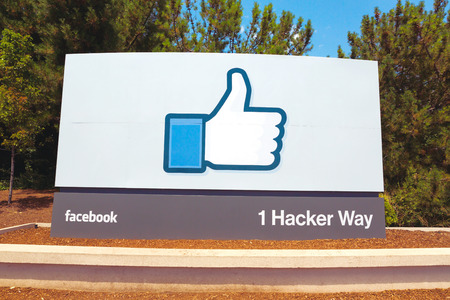 social networking service: MENLO PARK, CA - JULY 17: A sign at the entrance to the Facebook World Headquarters located in Menlo Park, California on July 17, 2014. Facebook is a popular online social networking service