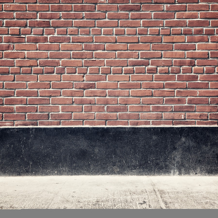 materia: Urban background with brick wall and pavement Stock Photo