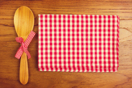 tablecloth: Tablecloth and wooden spoon