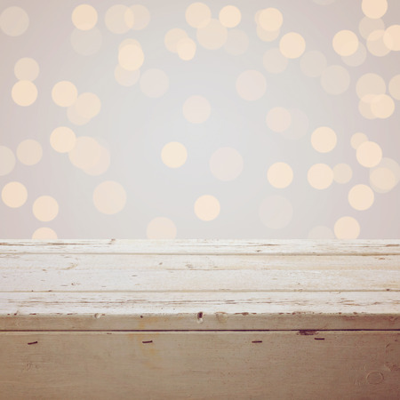 holiday lights display: Christmas background with empty wooden table