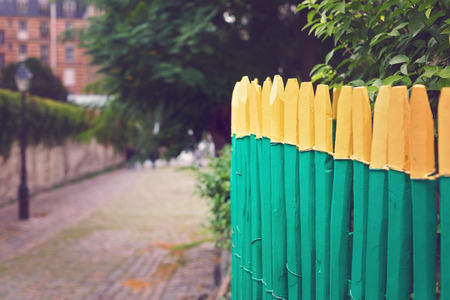 Wooden painted fence with selective focus photo