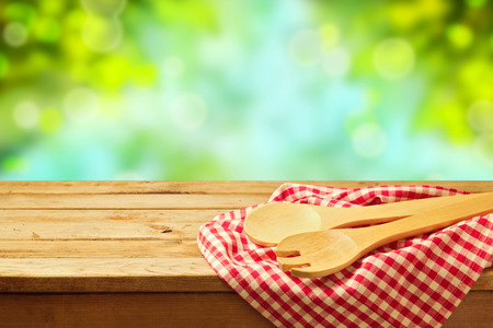 kitchen utensil: Kitchen utensil over garden bokeh background