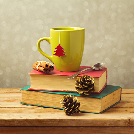 Christmas tea mug on books with decorations