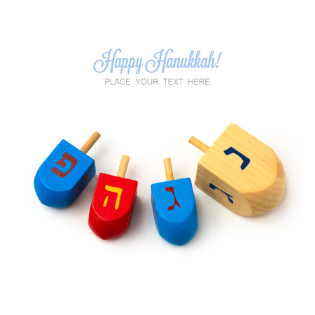 dreidel: Hanukkah wooden dreidel spinning top isolated on white background