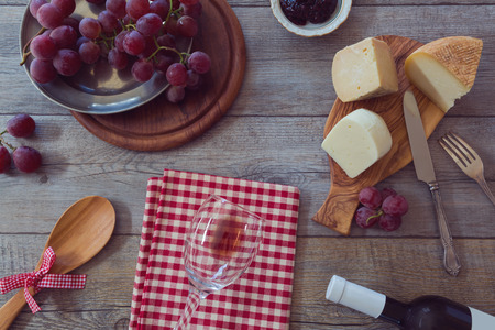 dairy product: Wine, cheese and grapes on wooden table. View from above