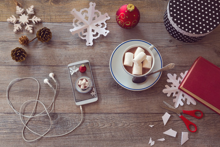sweet table: Christmas holiday celebration items for Preparing paper snowflakes. View from above with copy space
