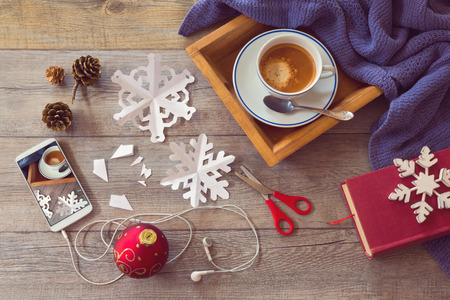 coffee table: Christmas holiday celebration items for Preparing paper snowflakes. View from above.