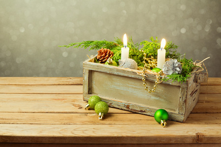 candle light table setting: Wooden box with Christmas decorations and candles
