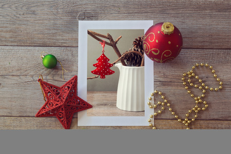 christmas bauble: Christmas decoration photo on wooden table with ornaments. View from above Stock Photo