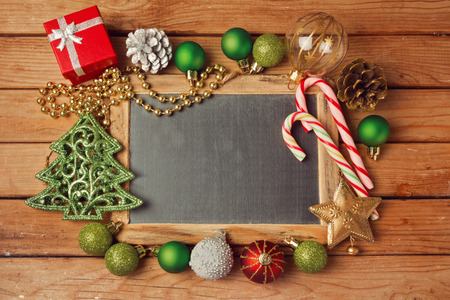Christmas holiday background with blank chalkboard and Christmas decorations. Stock Photo
