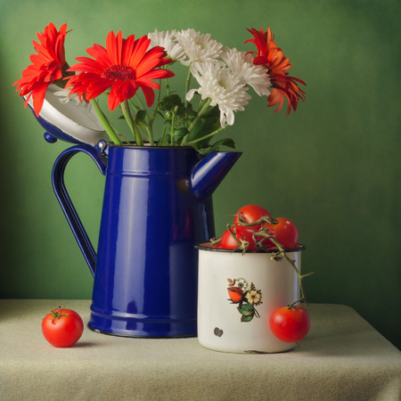 Vintage still life with flowers and cherry tomatoes photo