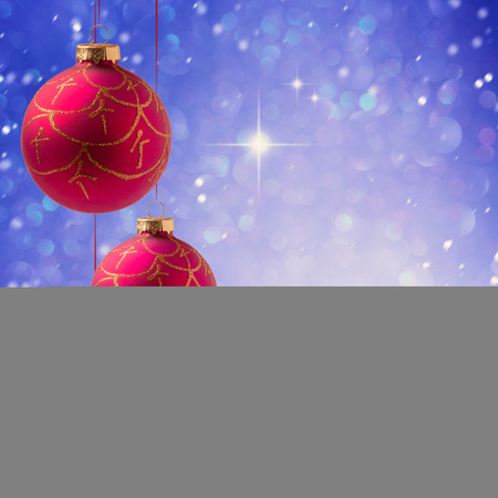 christmas poster: Christmas balls hanging over blue boke background with copy space