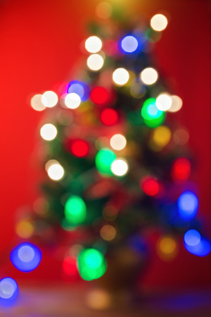 page background: Blured bokeh Christmas tree background Stock Photo