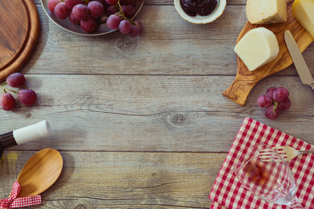 grapes: Wine, cheese and grapes on wooden table. View from above with copy space