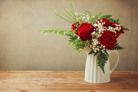 white flowers: Rose flower bouquet on wooden table with copy space