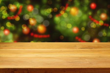 クリスマス ツリー ボケ背景空ウッドデッキ テーブル 写真素材