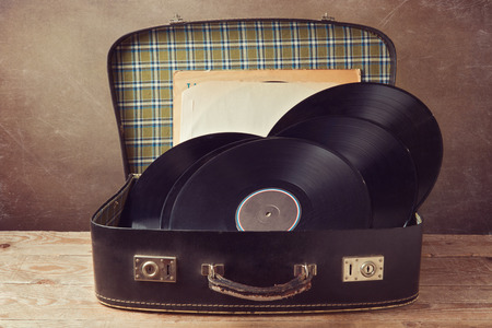 Vintage suitcase with old music records Stock Photo