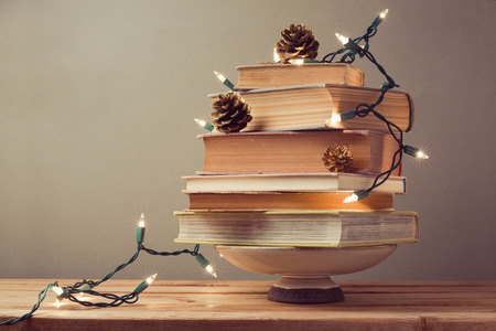 christmas backdrop: Christmas tree made from books. Alternative Christmas tree
