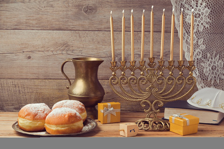 jewish food: Jewish holiday hanukkah celebration with vintage menorah Stock Photo