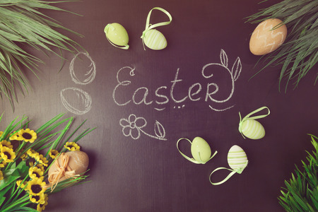 papiermache: Easter decorations on chalkboard. View from above