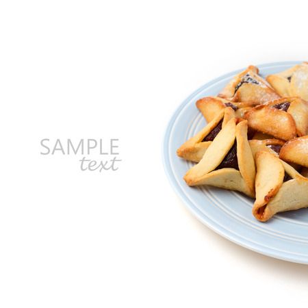 haman: Hamantaschen cookies on plate on white background Stock Photo