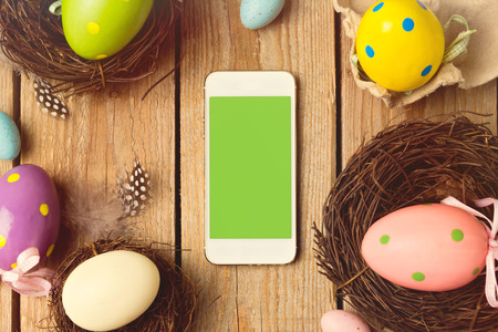 easter decorations: Smartphone mock up template for easter holiday app presentation Stock Photo