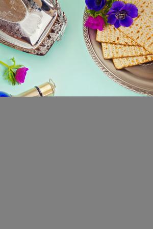 matzoth: Passover background with matzo, wine and flowers Stock Photo