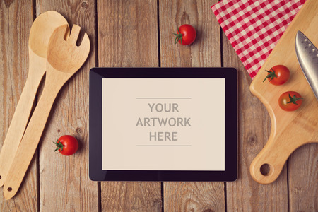 Tablet mock up template with cooking utensil. View from above 스톡 콘텐츠