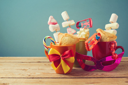 hamantaschen: Purim holiday gifts with cookies and candy in cups