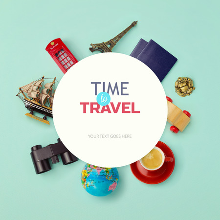 Objects related to travel and tourism around blank paper. View from above photo