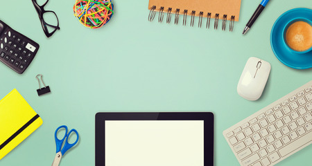 header image: Office supplies with tablet and keyboard