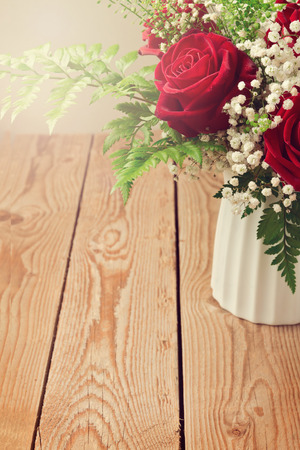 roses in vase: Background with rose flower bouquet close up