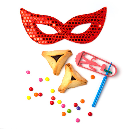 purim mask: Hamantaschen cookies , grogger and carnival mask on white background