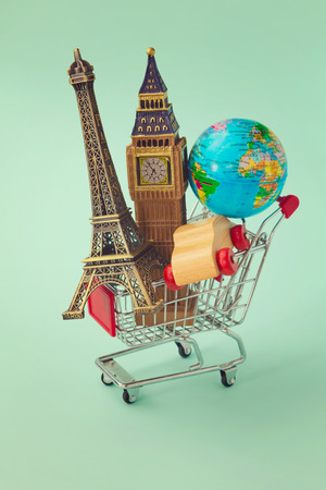 Shopping cart with souvenir from around the world. Retro filter effect Stock Photo