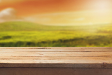 beautiful background: Wooden table over beautiful blur landscape background Stock Photo