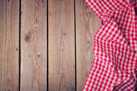 tablecloth: Wooden old table with checked tablecloth. View from above