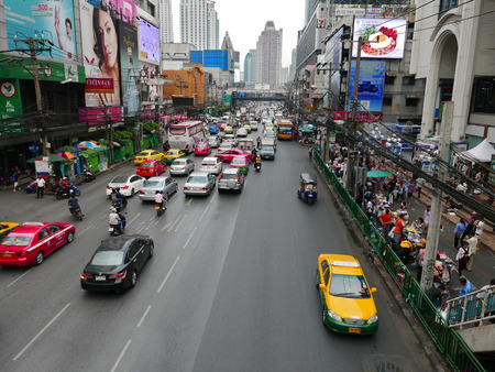 traffic jams: BANGKOK, THAILAND - JANUARY 31, 2015: City traffic on one of the central streets of Bangkok. Bangkok city is known for traffic jams Editorial